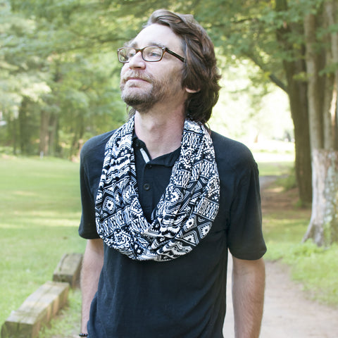 Journalist Randy Kalp wearing the Las Cruces Summer Hidden Pocket Travel Scarf on a wooded hiking trail.