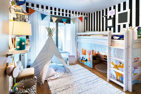 Use coordinating colors to make contrasting patterns blend together in kids' rooms.