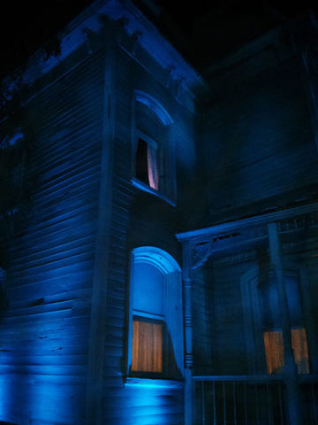 Just adding a blue light to silhouette your house against the dark is enough to give you chills.
