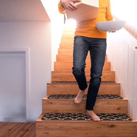 man walking down stairs with attachable carpet stair treads