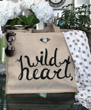 Wild Heart Tan Linen Double Sided Tote with silver winged heart necklace-pin