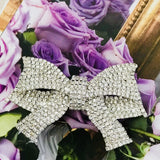 Big and beautiful silver crystal statement bow pin-brooch
