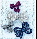 Set of four bows-necklace-brooch-bouquet pin-on sale for a limited time! $79.50