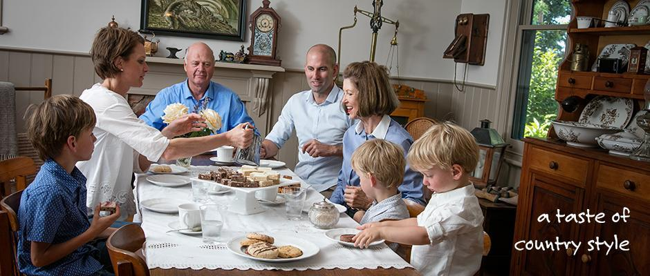 family sitting around table for morning tea