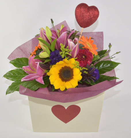 Florist's choice Valentines bouquet in a bag.