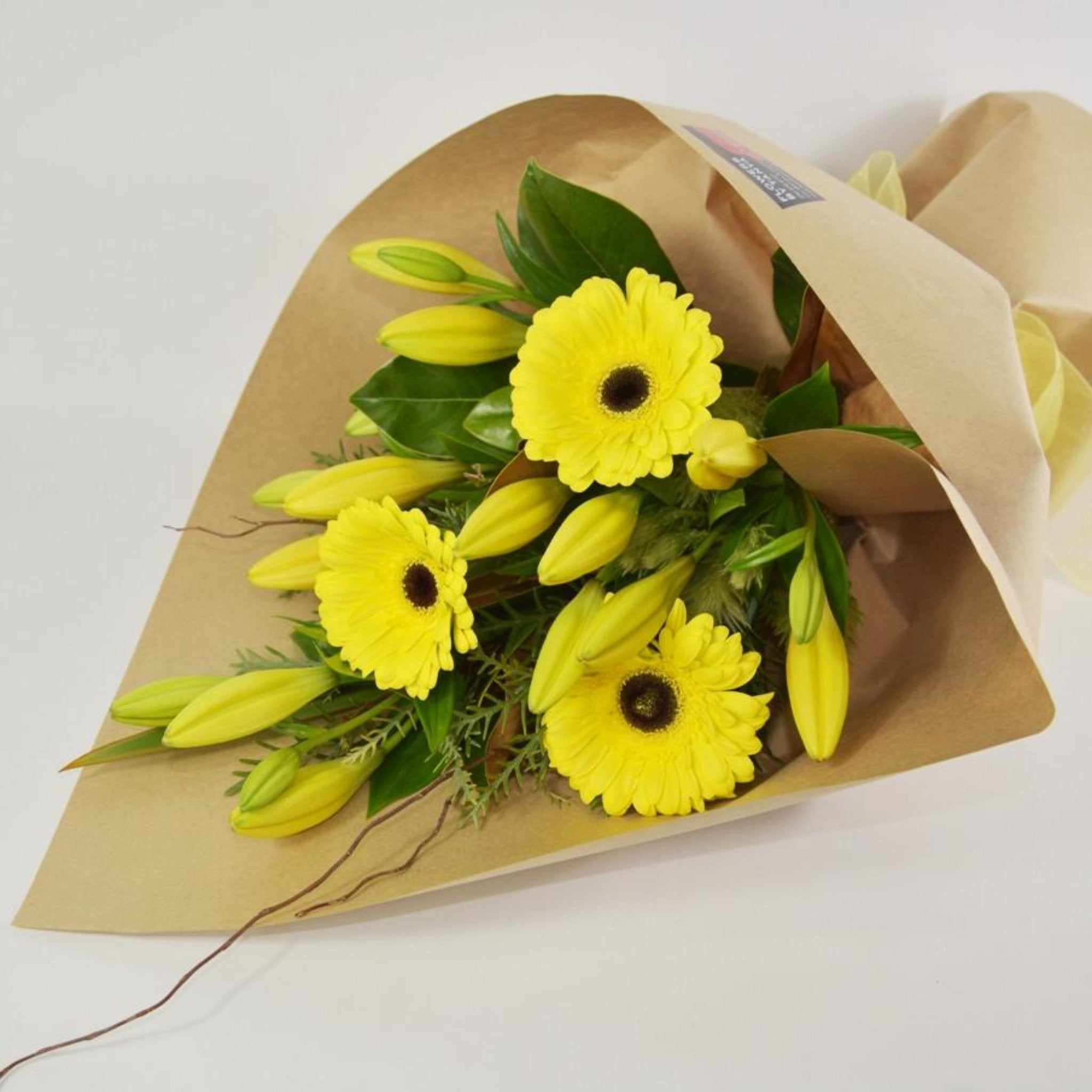 Lilies And Gerberas In Brown Paper Flowers By Tanya