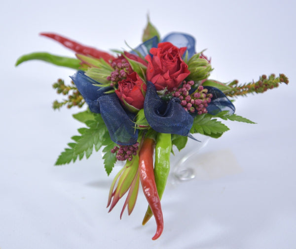 Red corsage for a Navy dress.