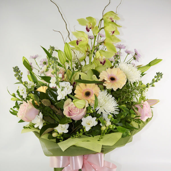 Orchids and flowers in a waterbox