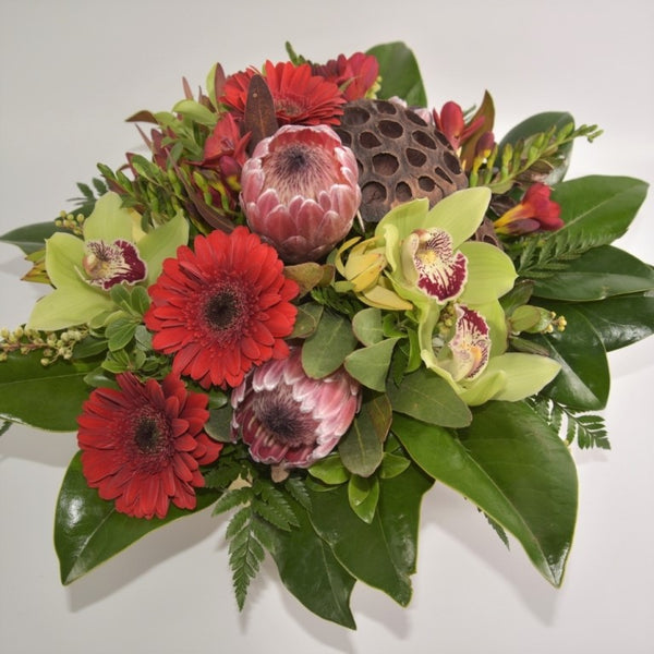 Florist choice: Flax Box Arrangement including Red Flowers