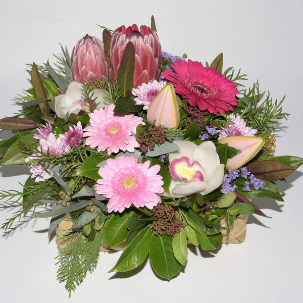 Florist choice: Flax Box Arrangement in Pink Tones