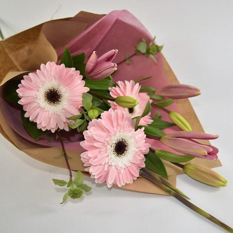 Lilies and Gerberas in Brown Paper
