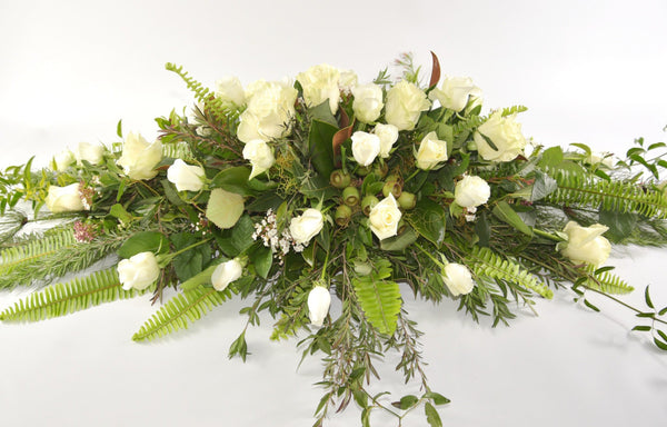 Perfect white rose casket spray