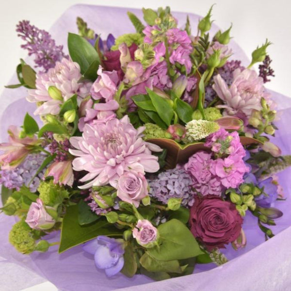 Florist Choice: Purple, Mauve and Pink toned Bouquet or Waterbox