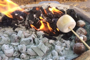 Toast marshmallows around the bonfire