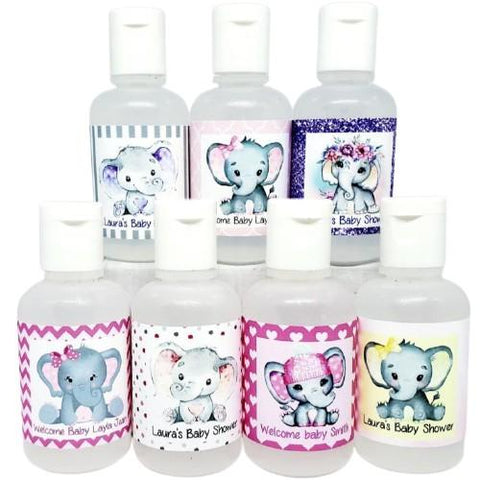Personalized girl pink elephant baby shower hand sanitizer favors.