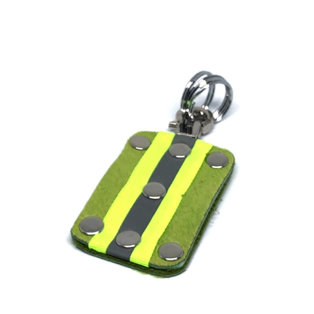 HAIR-ON COWHIDE WITH NEON YELLOW AND SILVER REFLECTIVE BAND KEY CHAIN. By NYET Jewelry.