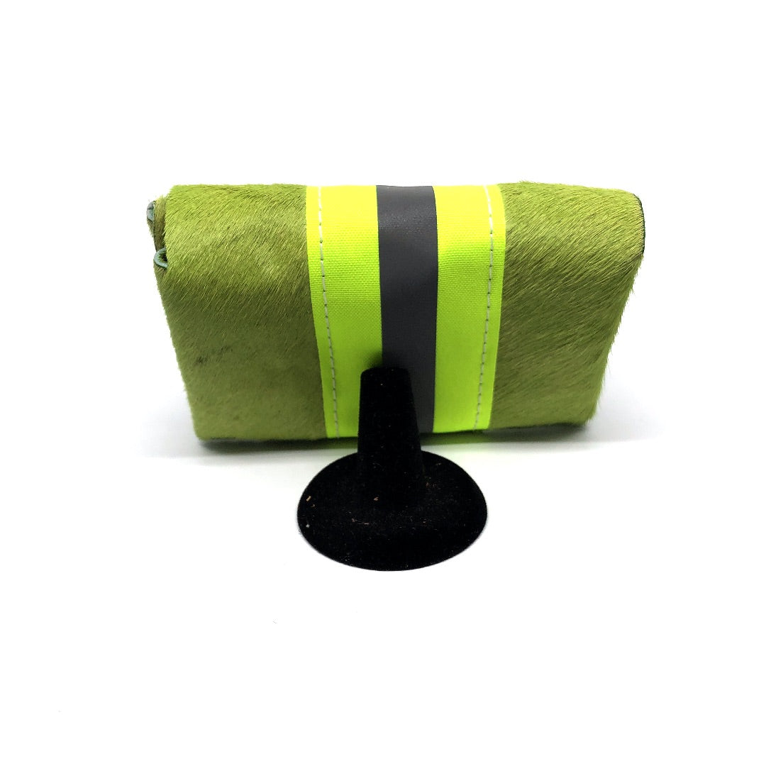 Made of hair-on cowhide leather, dyed cheerful grass blade green. neon yellow and silver reflective band runs along the length of the wallet.
