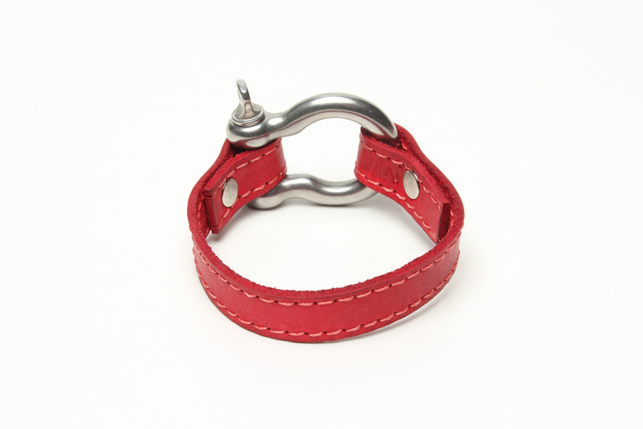 SIGNATURE STITCHED LEATHER AND STAINLESS STEEL SHACKLE BY NYET JEWELRY.