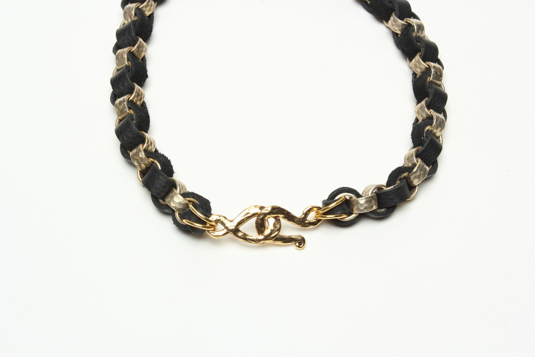 GOLD HAMMERED STEEL CHAIN AND DEERSKIN LEATHER NECKLACE WITH GOLD STIRRUP. by NYET Jewelry.
