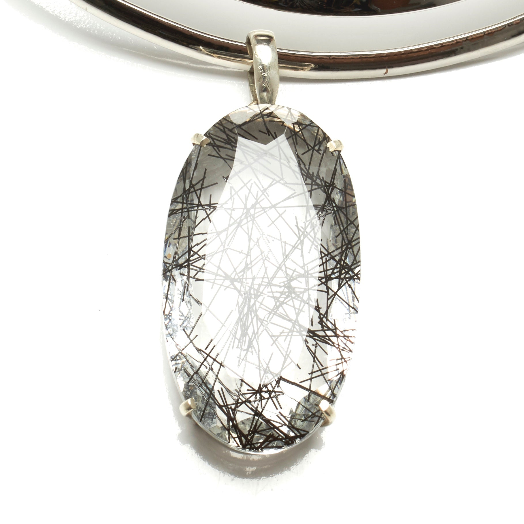 THICK TORQUE NECKLACE WITH LARGE TOURMALINATED QUARTZ PENDENT. BY NYET JEWELRY