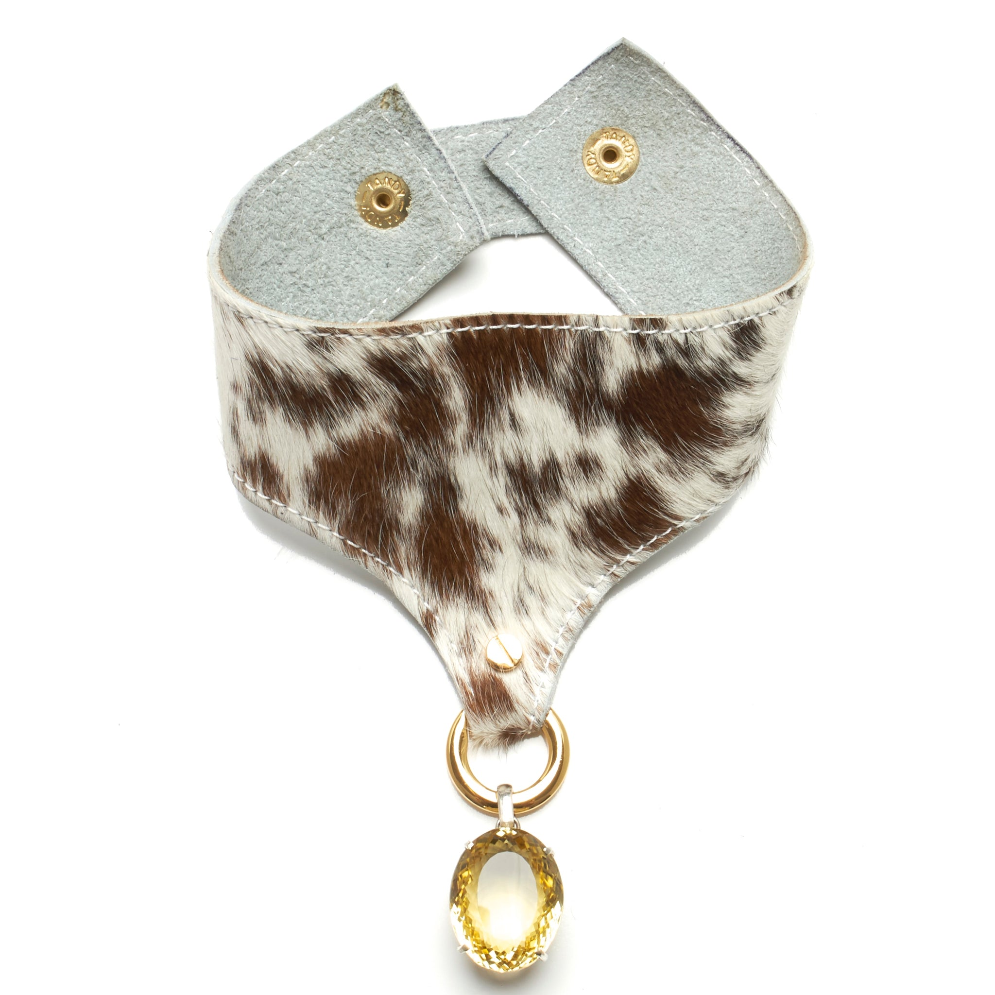 WIDE HAIR-ON COWHIDE CHOKER WITH LARGE SILVER PENDANT WITH FACETED CITRINE STONE. BY NYET JEWELRY.