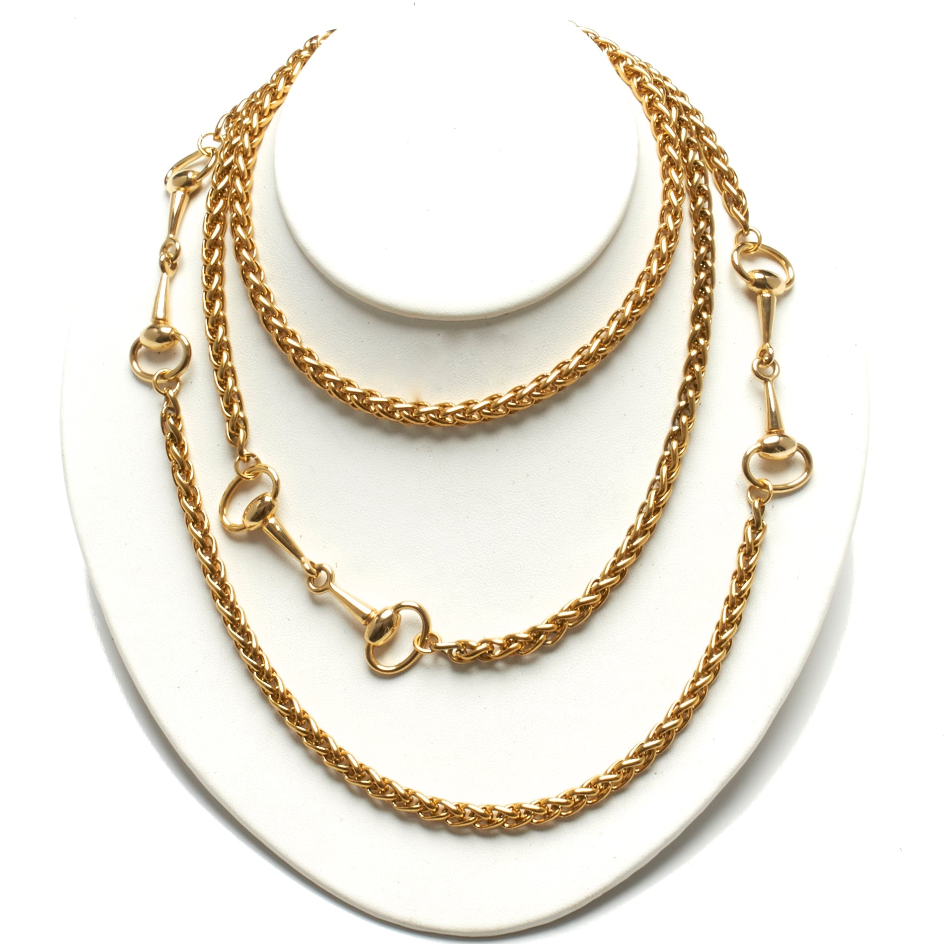 LONG GOLD PLATE OVER STAINLESS STEEL NECKLACE ADORNED WITH THREE SOLID BRASS HORSE-BIT ACCENT HARDWARE. by NYET Jewelry.