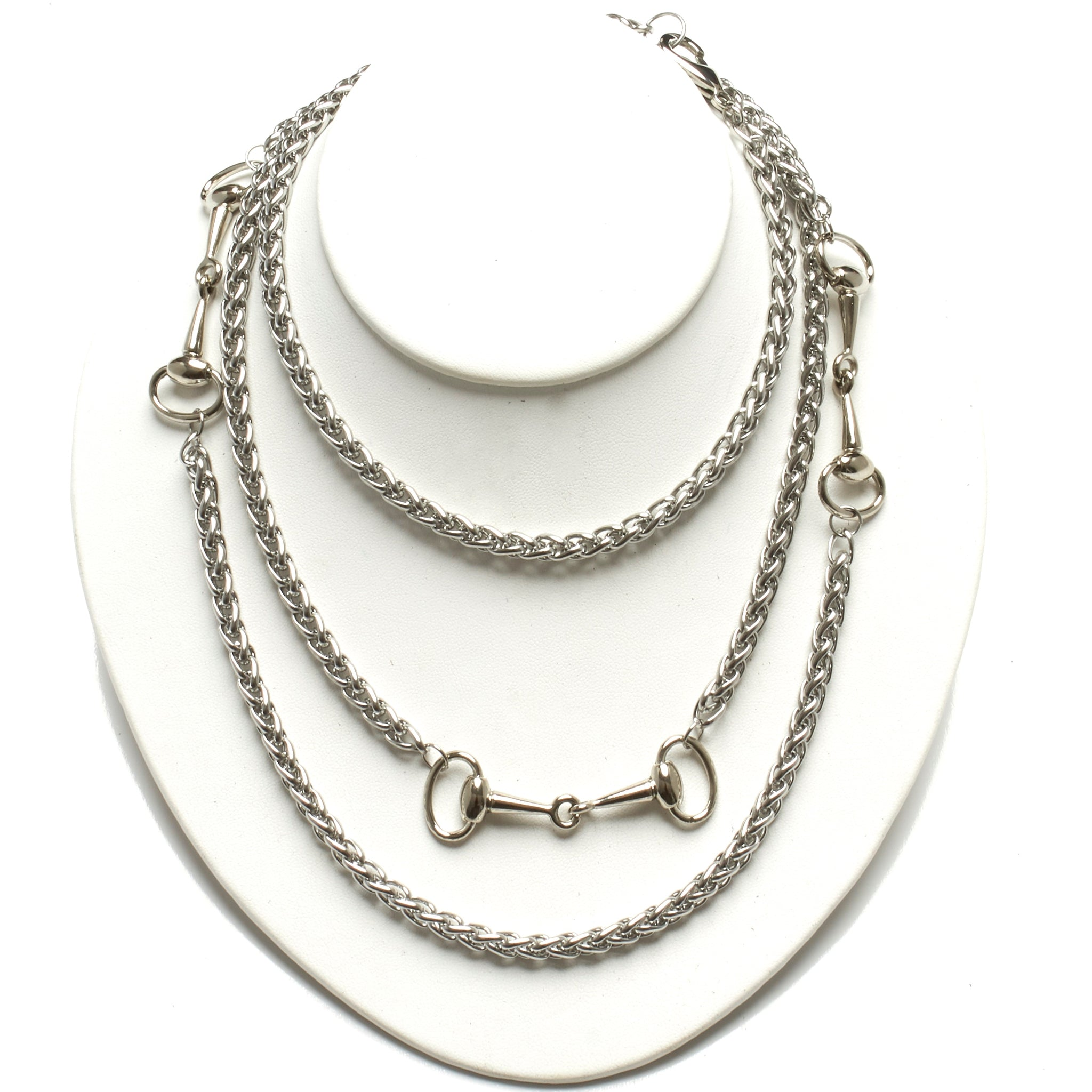 LONG STAINLESS STEEL NECKLACE ADORNED WITH THREE HORSE-BIT ACCENT HARDWARE. by nyet jewelry.