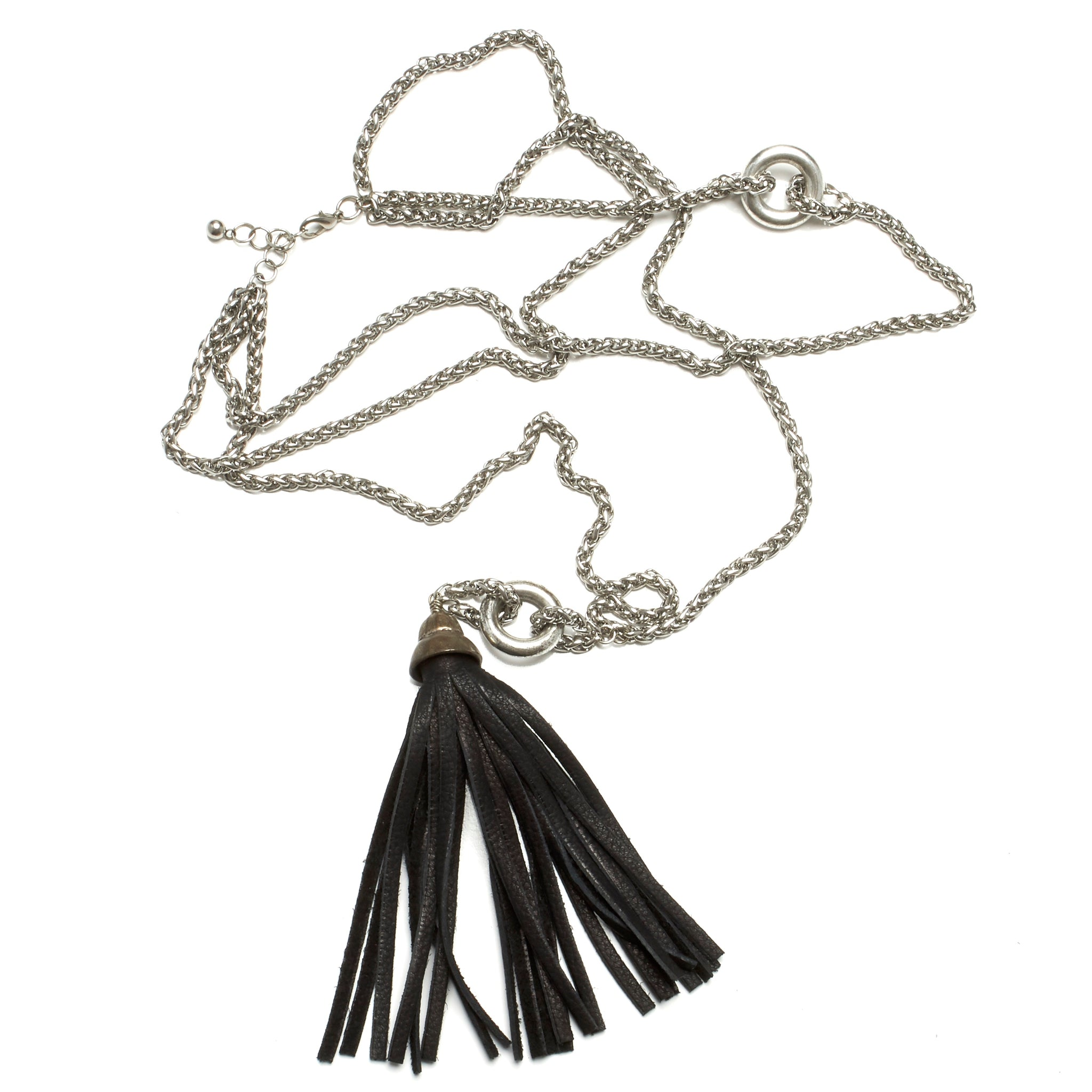 TRIPLE ROW STAINLESS STEEL NECKLACE WITH LONG DEERSKIN TASSEL BY NYET JEWELRY.