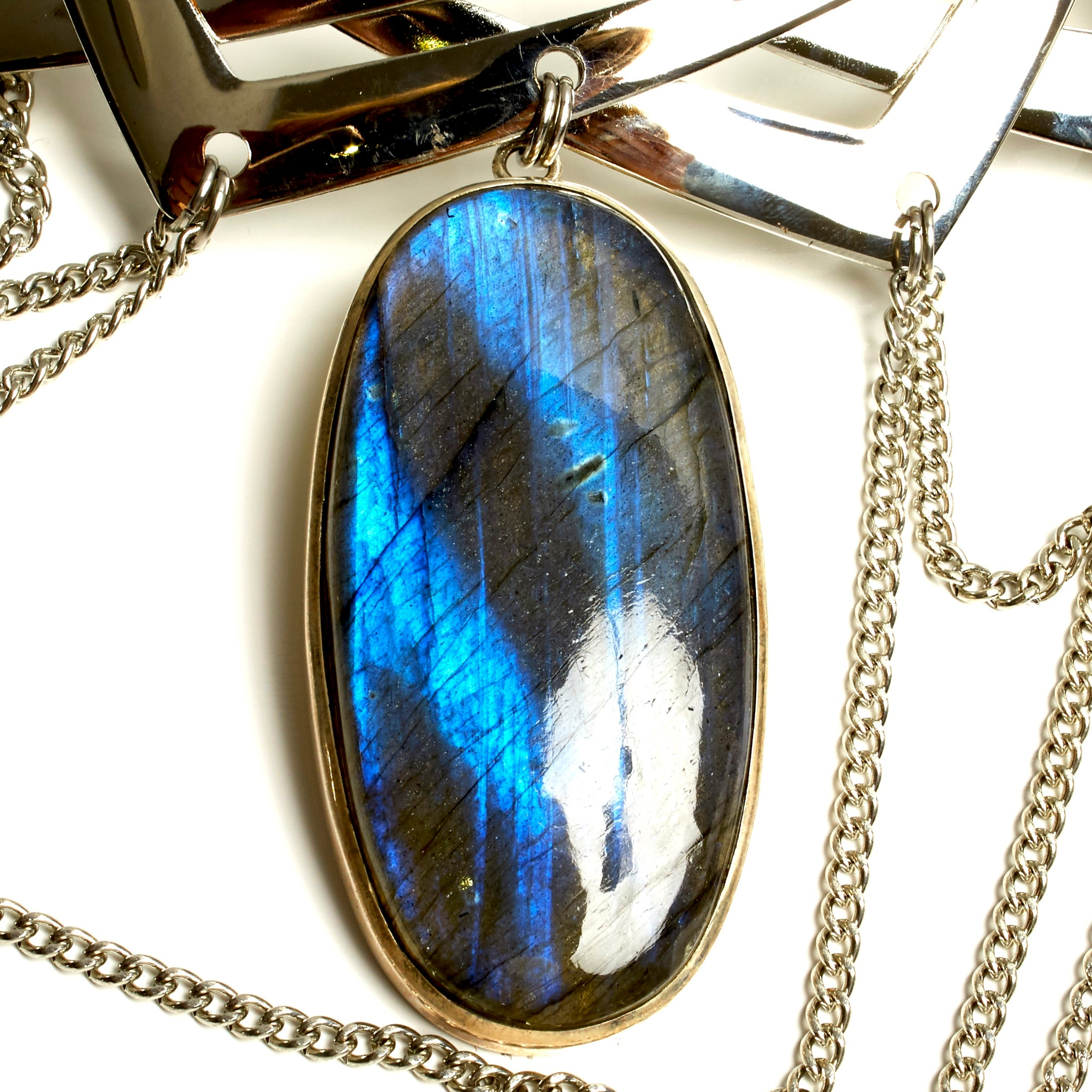INTRICATE TORQUE NECKLACE WITH CHAINS AND LARGE LABRADORITE STONE PENDENT. by nyet jewelry.