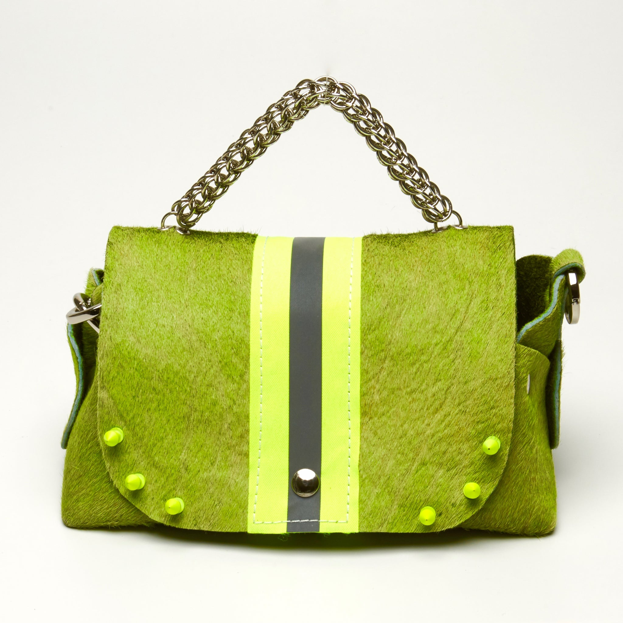 HAIR-ON COWHIDE LEATHER WITH WIDE NEON YELLOW REFLECTIVE TRIM RIVETED DAY-TO-EVENING BAG WITH STAINLESS STEEL METAL HARDWARE, CHAIN MAILLE HANDLE AND REMOVABLE SHOULDER STRAP.