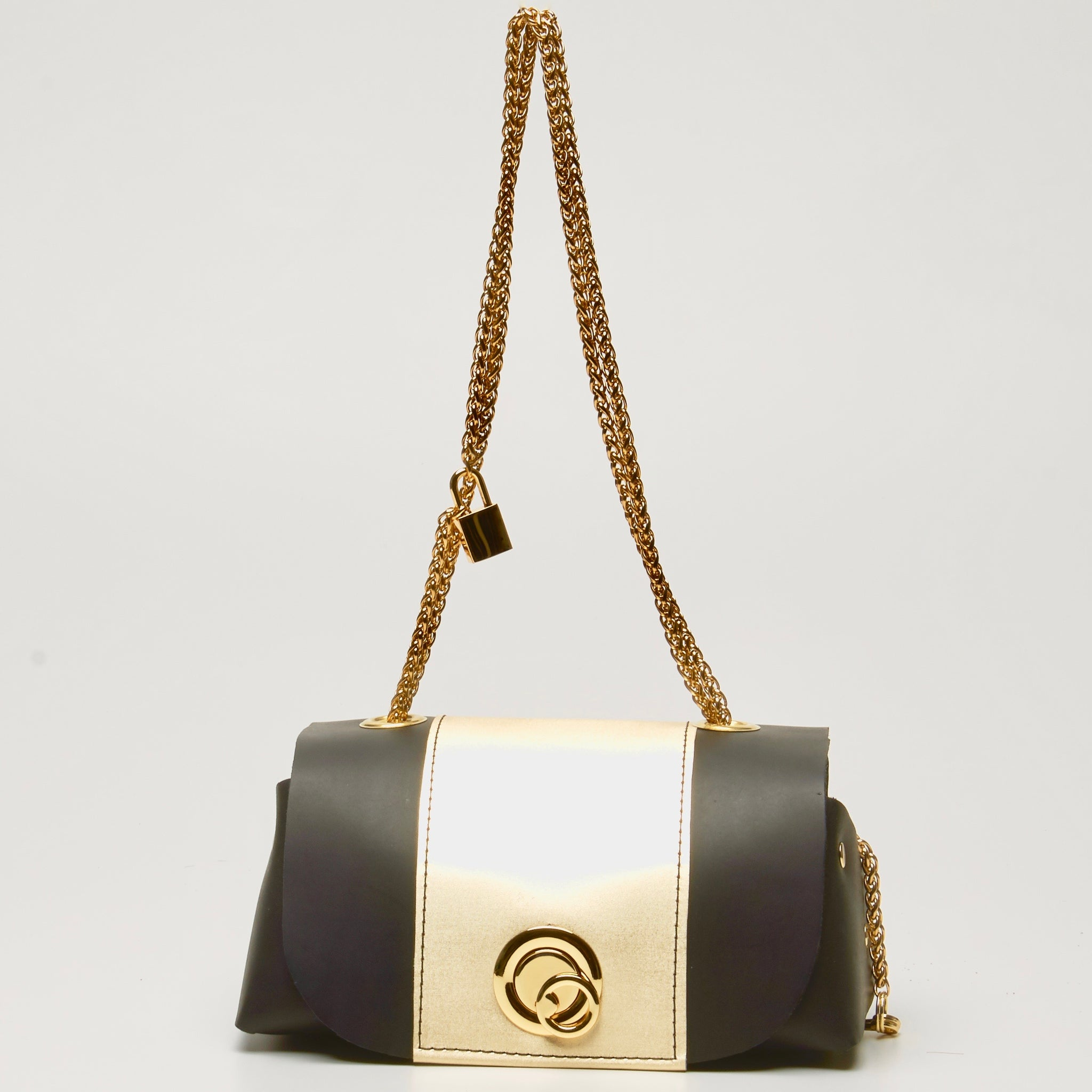 "black and gold leather ""grande lunch bag"" by NYET Jewelry."