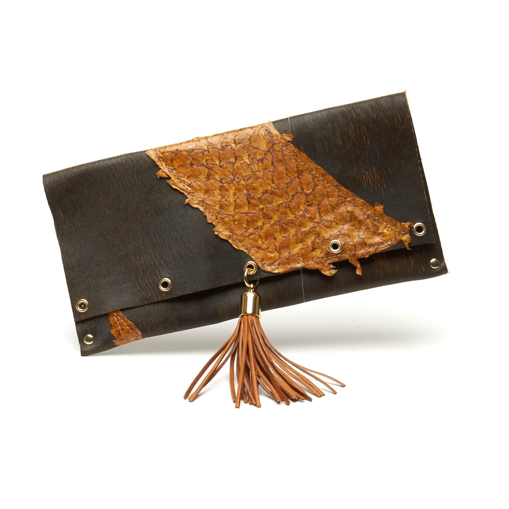LASER CUT COWHIDE AND FISH LEATHER CLUTCH WITH DEERSKIN TASSEL AND MAGNETIC CLOSURE. by NYET Jewelry