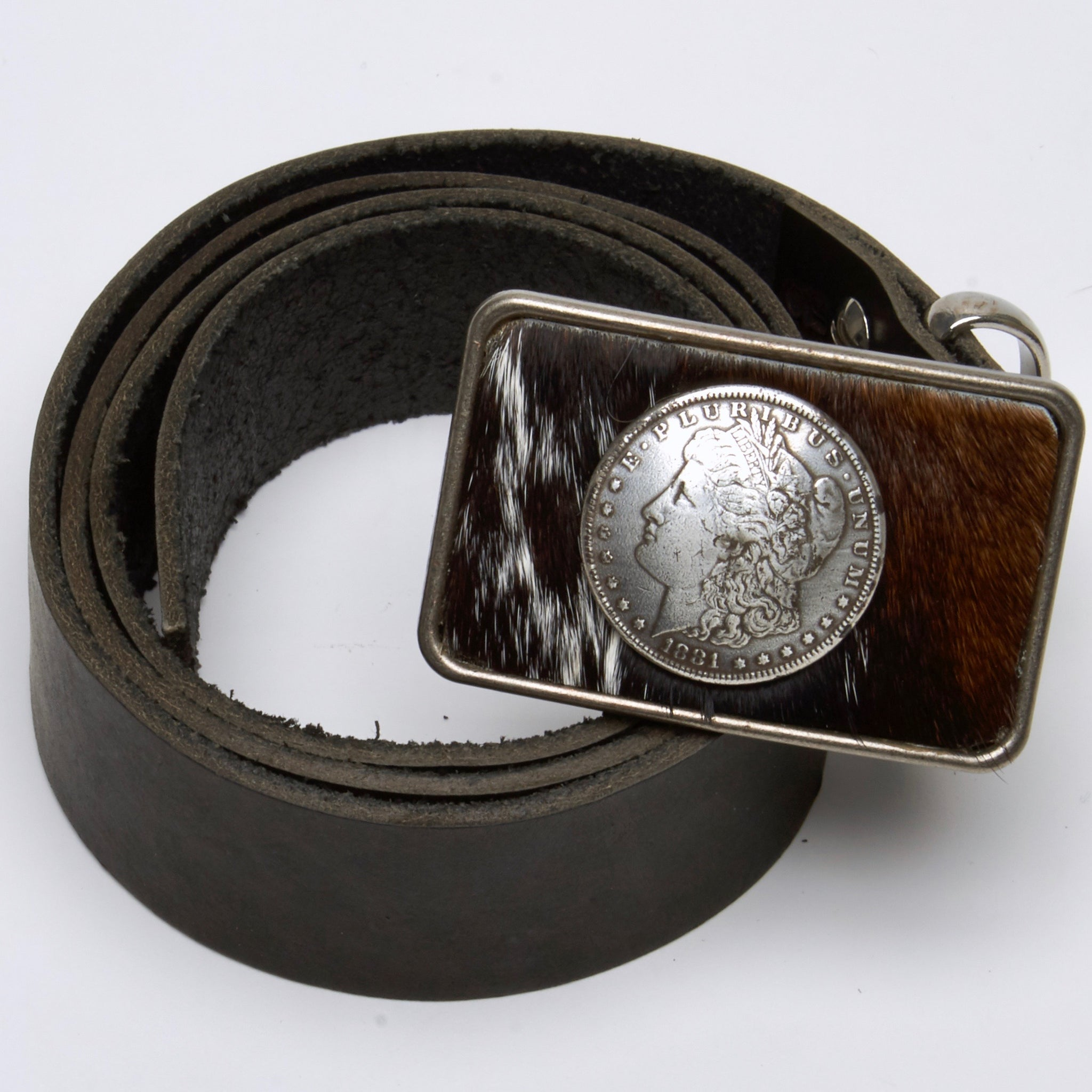 HAIR-ON COWHIDE BELT WITH SILVER DOLLAR CONCHO ON THE BUCKLE by NYET Jewelry.