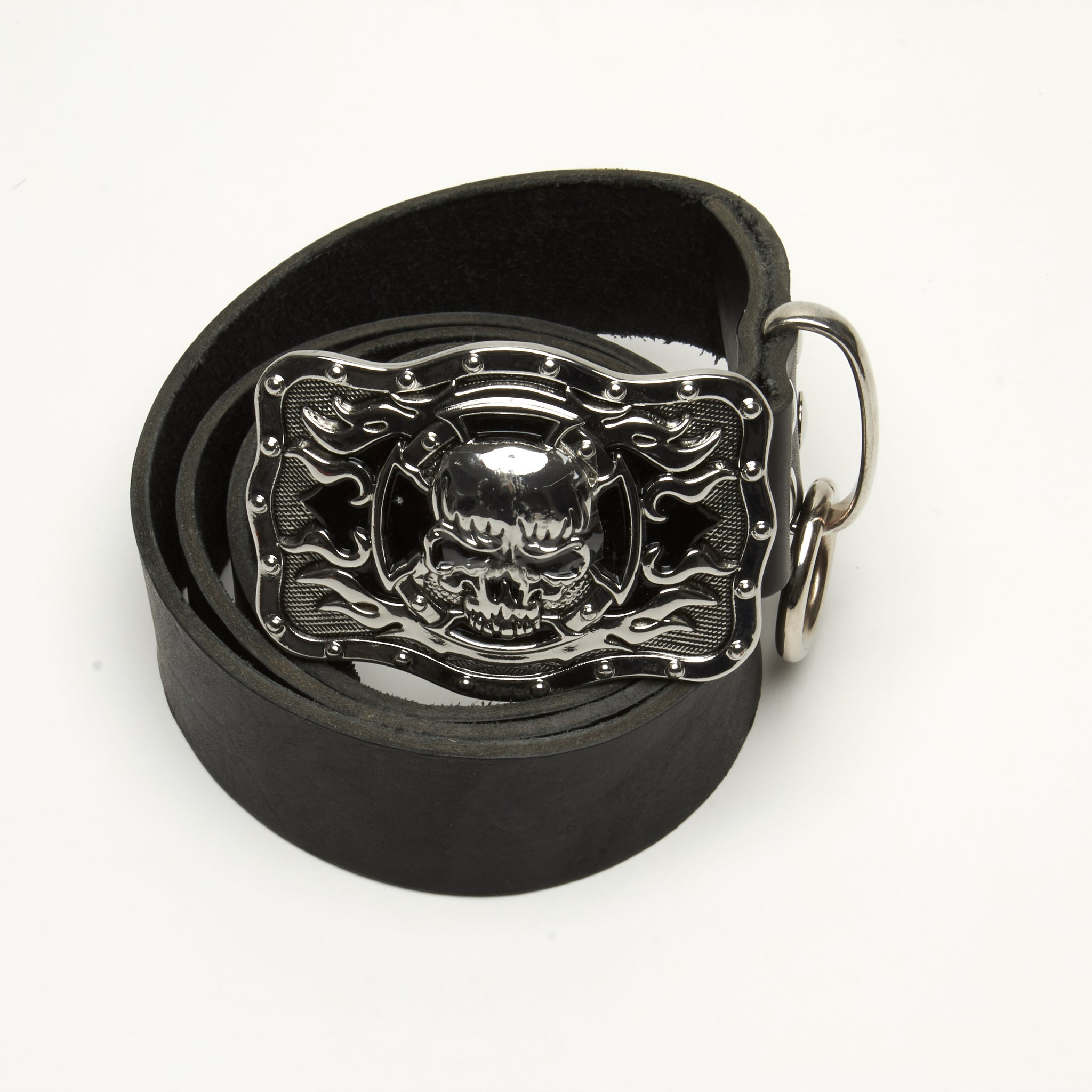 LEATHER BELT WITH HEAVY METAL AND BLACK ENAMEL SKULL BUCKLE ADORNED WITH THICK RING AT BELT LOOP. by NYET Jewelry.