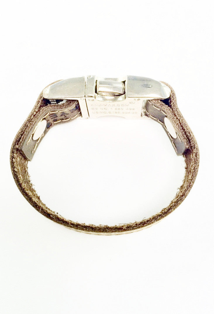 Distressed leather bracelet with side squeeze aluminum buckle