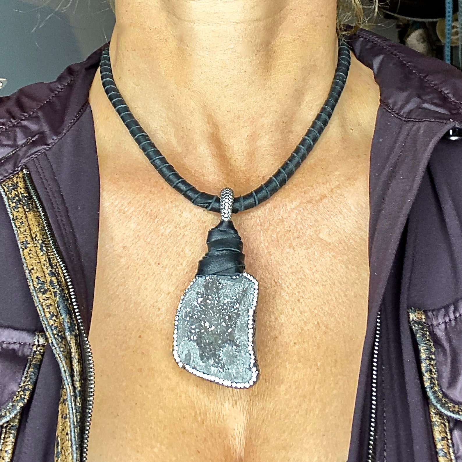 Silver druzy stone and deerskin necklace by NYET Jewelry.