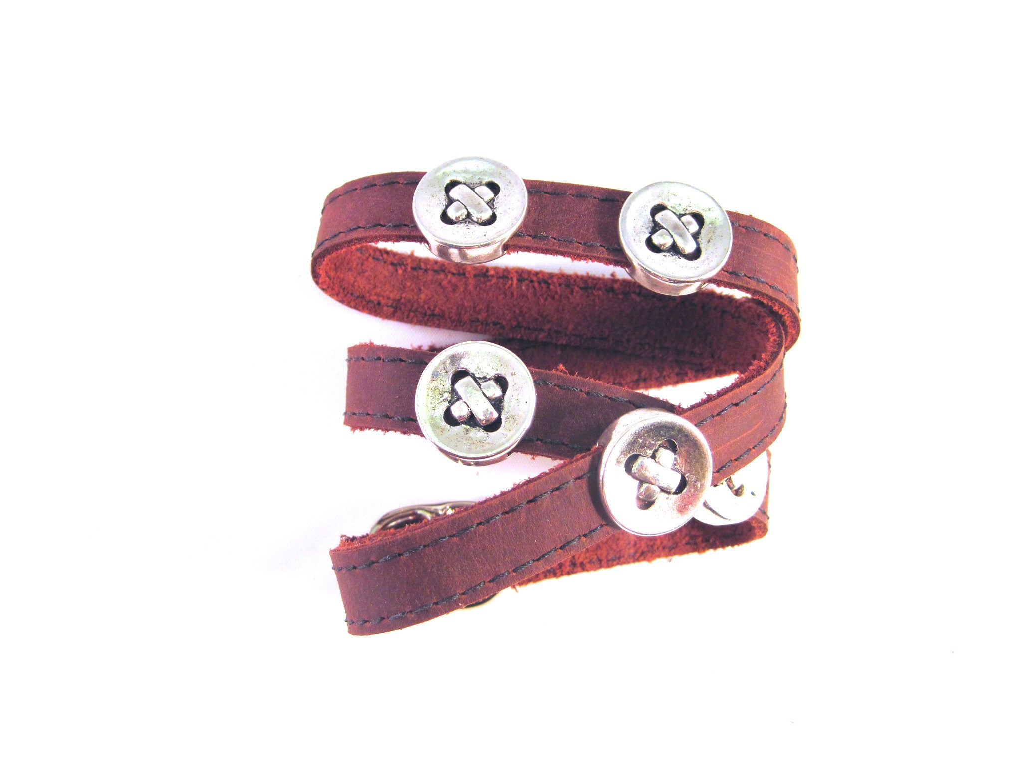 LEATHER WRAPAROUND WITH FIVE METAL BUTTONS by nyet jewelry.