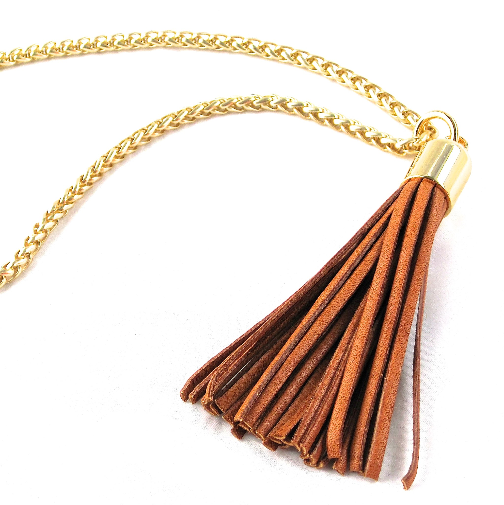 STAINLESS STEEL CHAINS AND LARGE DEERSKIN LEATHER TASSEL NECKLACE by nyet jewelry