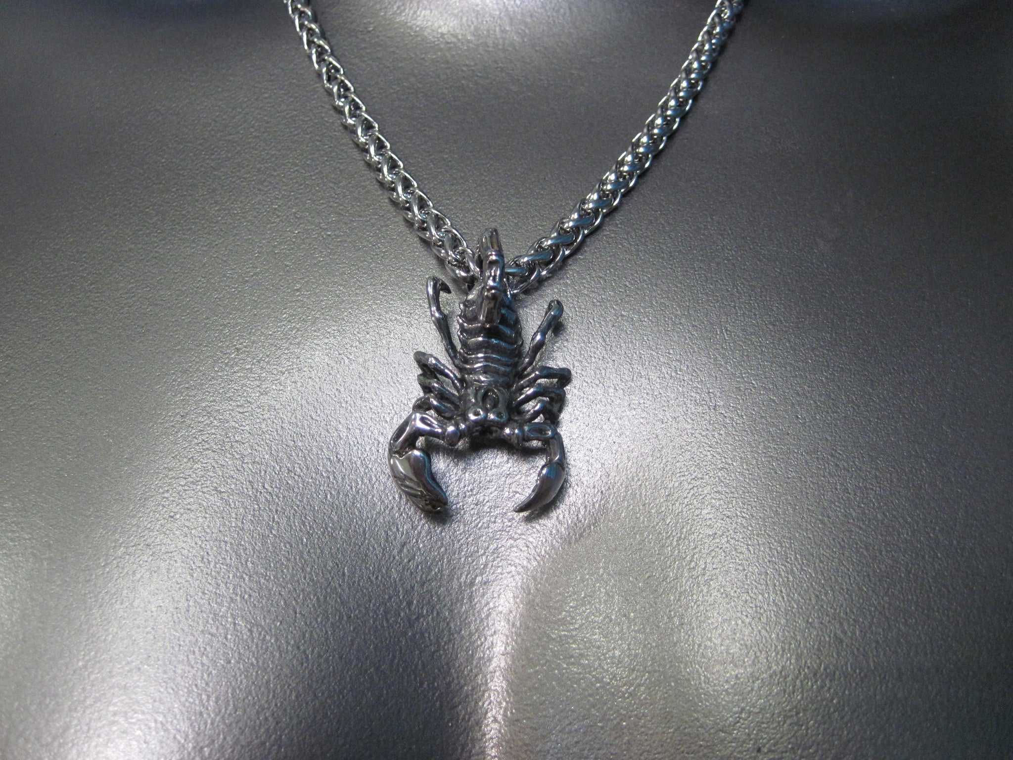 ROUND STAINLESS STEEL CHAIN NECKLACE WITH HEAVYWEIGHT SCORPION PENDANT. by nyet jewelry