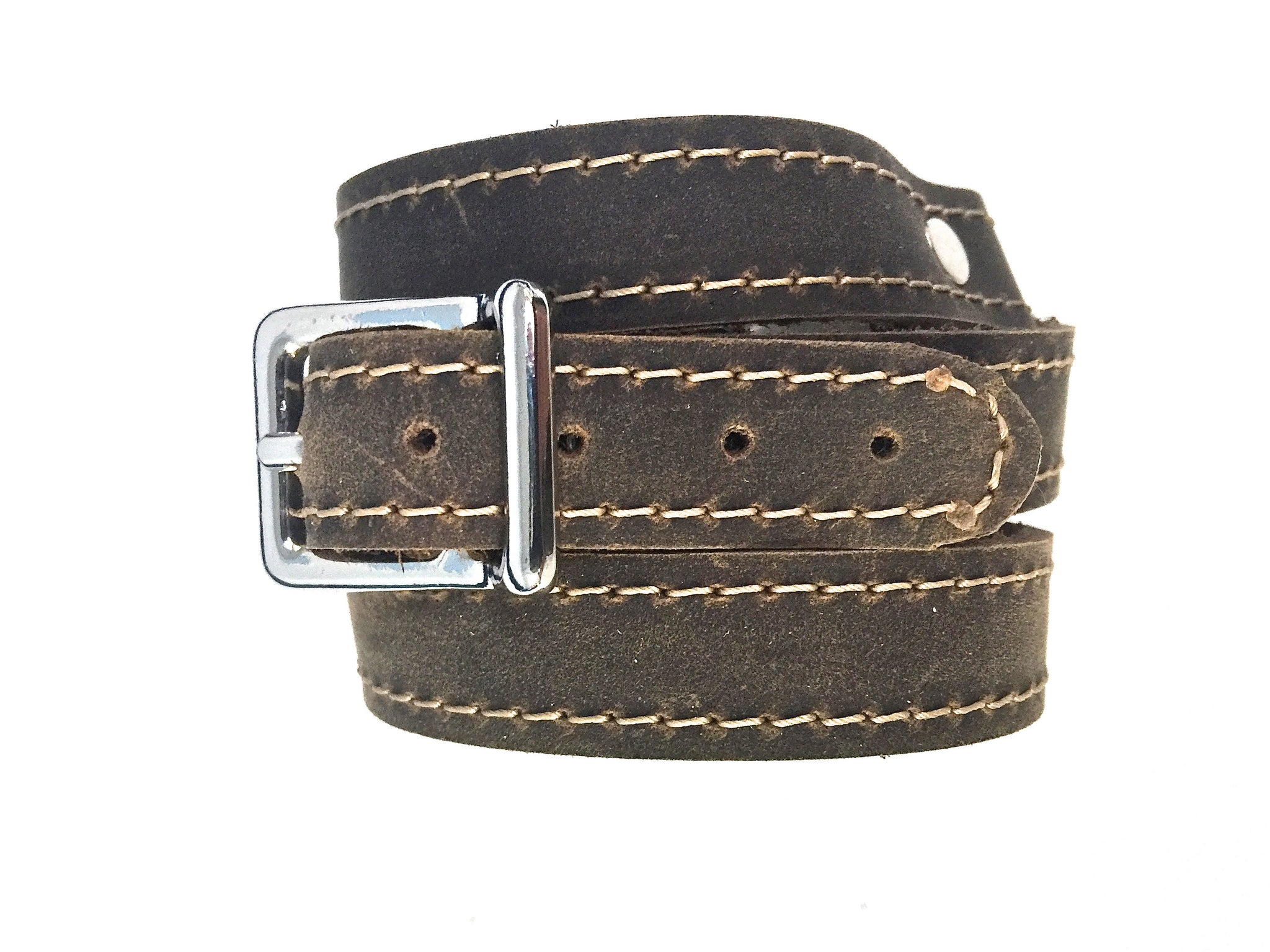 LEATHER WRAPAROUND WITH METAL LINK INLAID WITH MATCHING PIECE OF LEATHER
