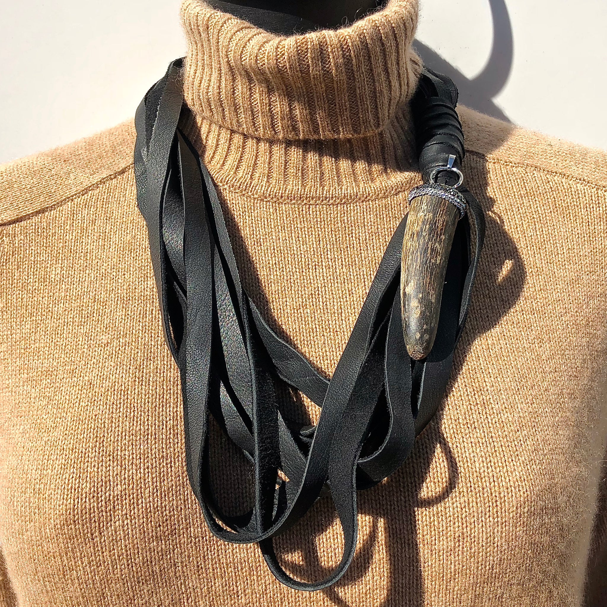 MULTI STRAND DEERSKIN LEATHER NECKLACE WITH PAVE RHINESTONE AND HORN PENDENT. by NYET Jewelry