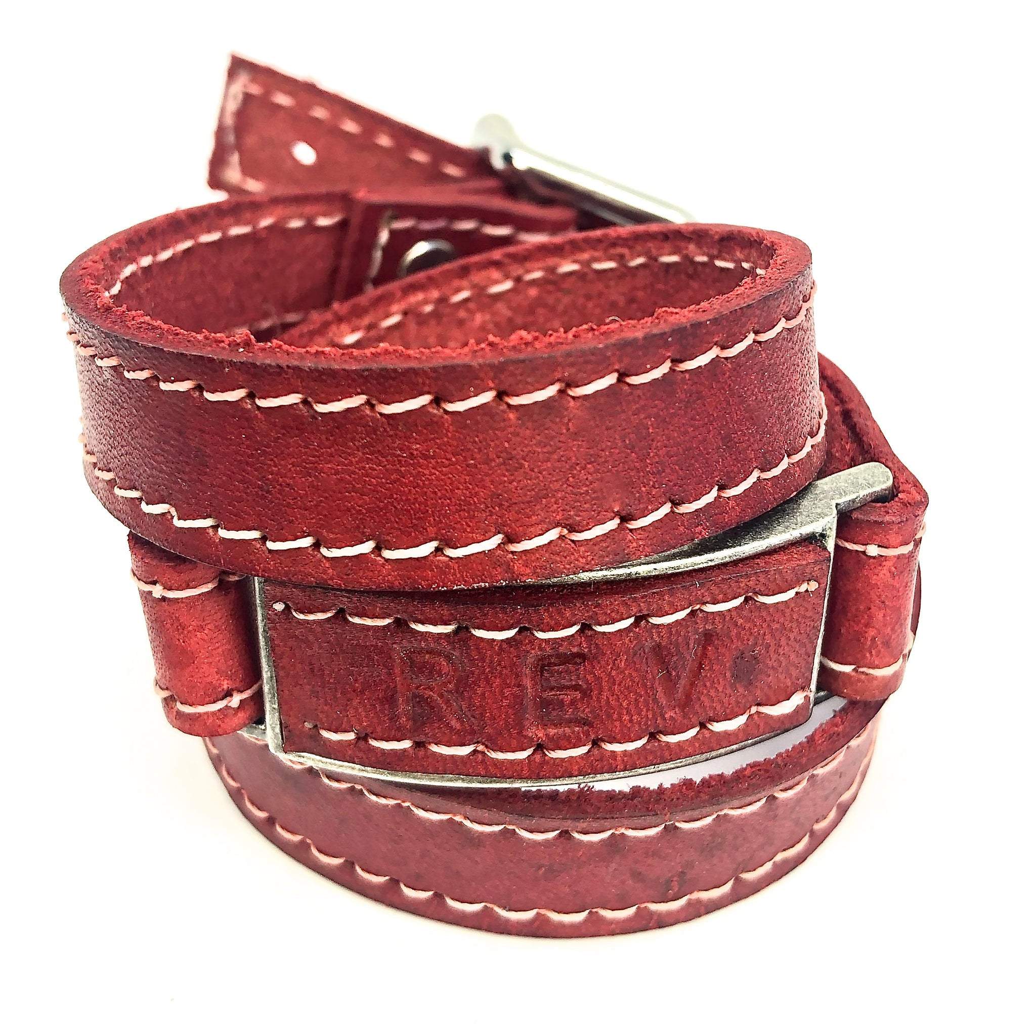 LEATHER WRAPAROUND WITH METAL LINK INLAID WITH MATCHING PIECE OF LEATHER WITH CUSTOM ENGRAVING by nyet jewelry