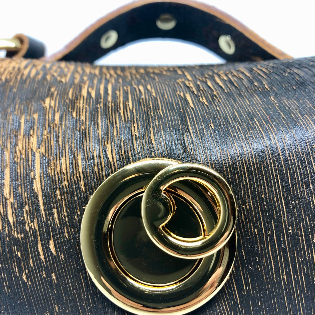 LASER-CUT LEATHER RIVETED EVENING BAG WITH METAL HARDWARE by NYET Jewelry