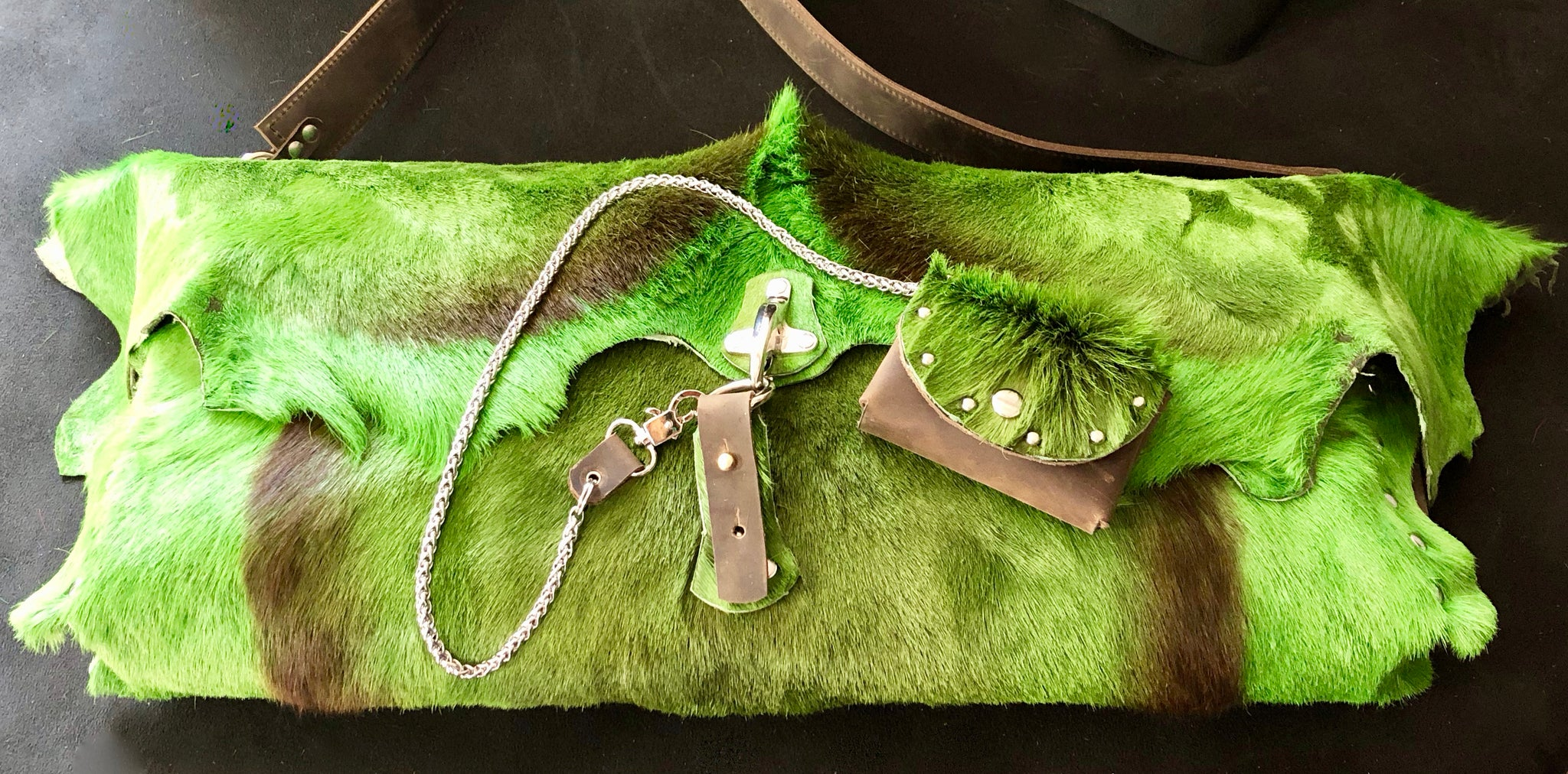 BRIGHTLY DYED SPRINGBOK OVERSIZED BAG WITH METAL HARDWARE AND MATCHING CHAIN WALLET by Nyet Jewelry