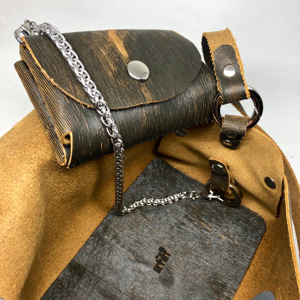 LASER-CUT LEATHER RIVETED EVENING BAG WITH METAL HARDWARE. by NYET Jewelry