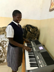Spoolies donation, keyboard for girls high school in Kitale Kenya with Sr. Freda