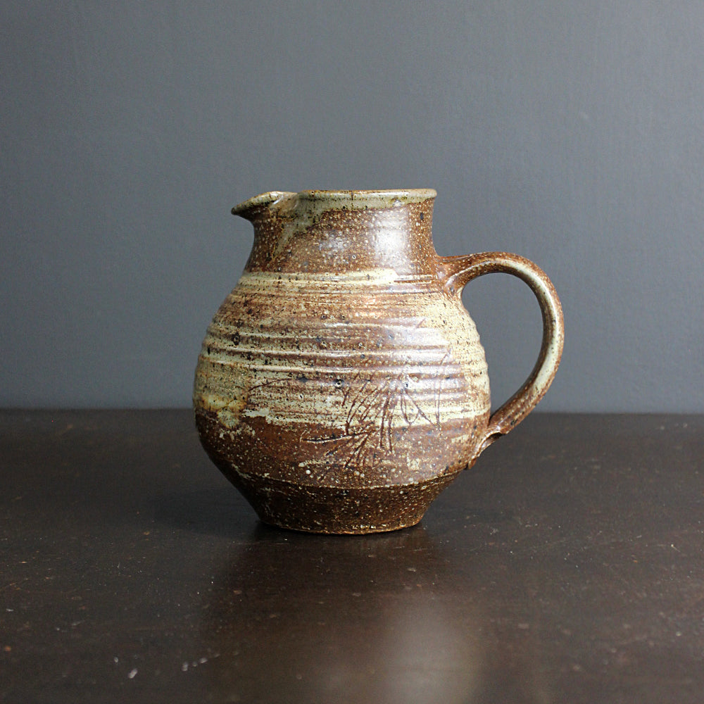 .Brown Handmade Pitcher