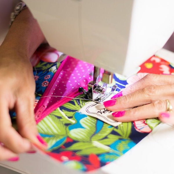 sewing on a Valere Rene tag