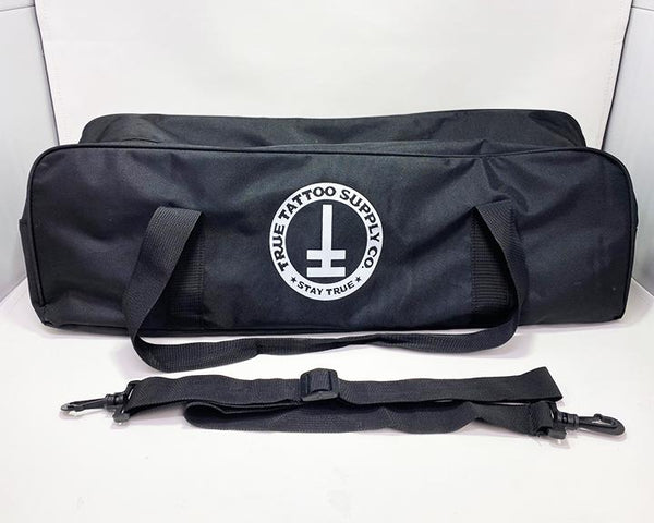 "Available at True Tattoo Supply. Armrest Travel Bags for your True Tattoo Armrest!  This convenient travel bag is perfect to fit your True Armrest as well as extra parts you may need while traveling! Two Handles for easy carrying and comes along with a strap for shoulder carrier.   Bag measures: L - 24"" H - 7"" W - 7"" Made Of: Nylon, Plastic"