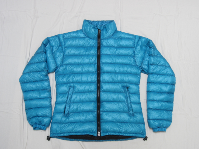 Ladies turquoise down jacket laid flat against white background